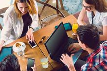 Nonprofit employees using Office 365 on laptops and mobile devices